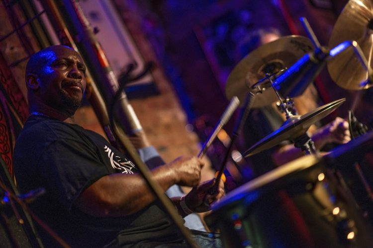 Ron D Aderson-aka-Dr. Sweat-plays-percussion-for-Midnight-Rider-Chicago-at-Reggie's-music-joint