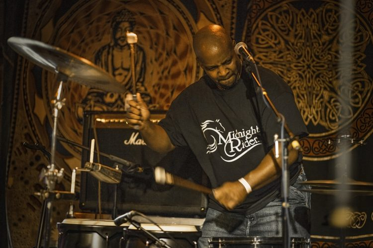 Ron D Anderson-plays-Bongo-Drums-with-Midnight-Rider-Band-at-Reggie's-Chicago